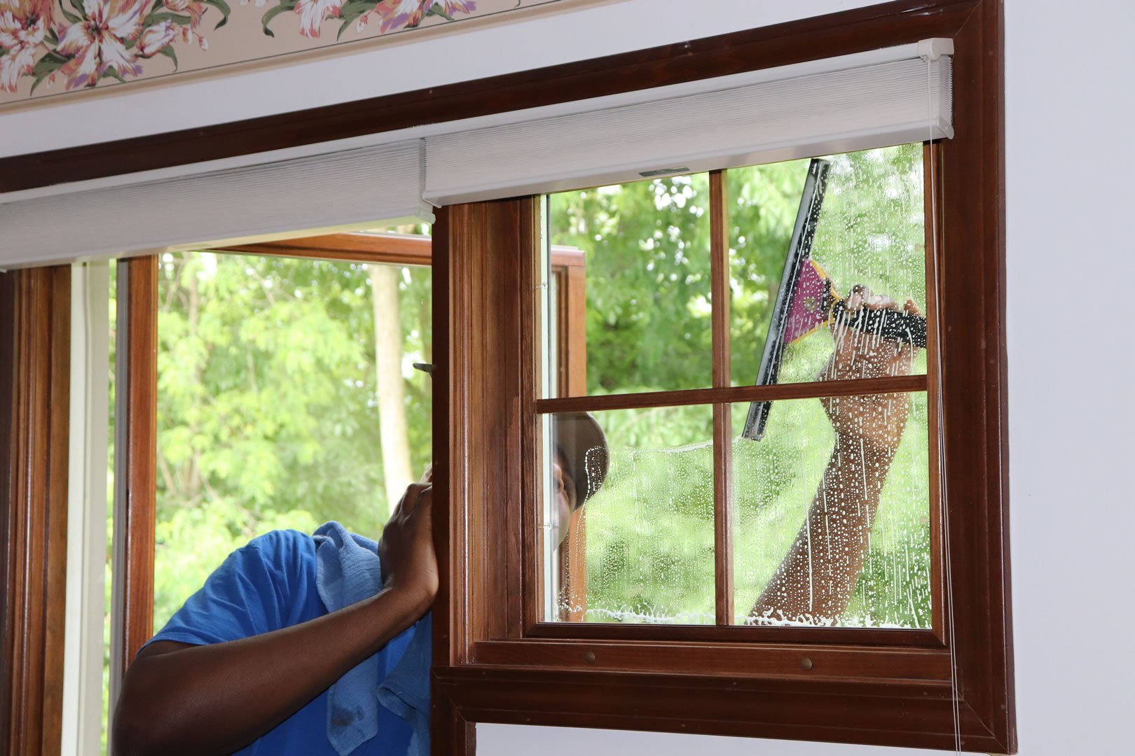 Charles Cleaning Bedroom Window